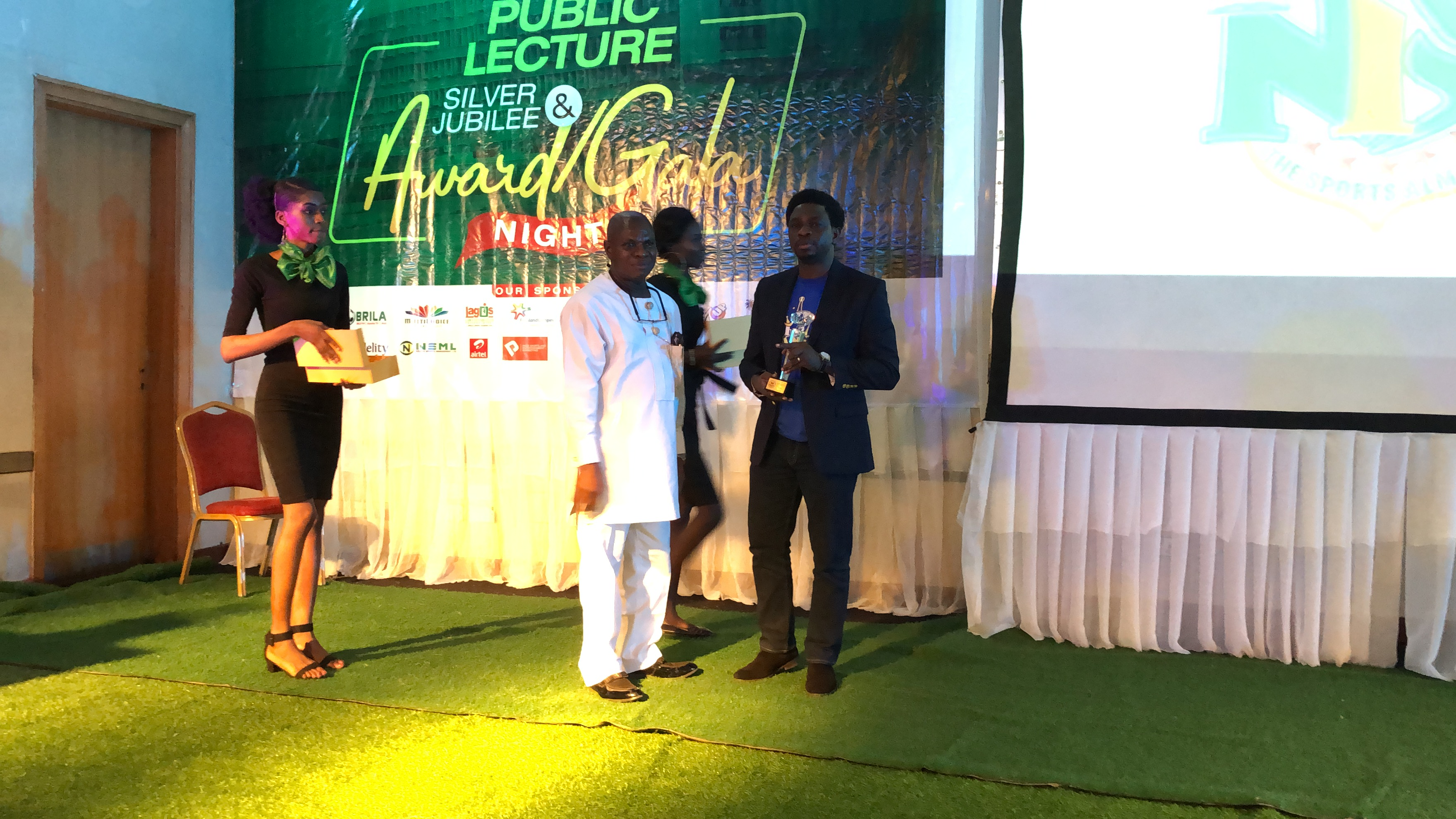 Kunle Ogidi receiving the award